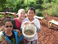 Children showing dry beans