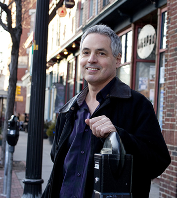 "Robert Sampson is the Harvard University Henry Ford II Professor of the Social Sciences; Director of the Social Sciences Program at the Radcliffe Institute for Advanced Study and the author of the new book, ""Great American City."" He was photographed in Inman Square. Rose Lincoln/ Harvard Staff Photographer"