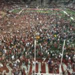 Fans packed onto the field at Martin Stadium