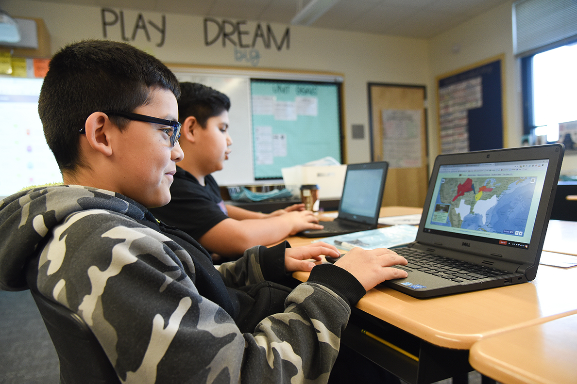 Two students uses PuzzleMap at Marcus Whitman Elementary School.