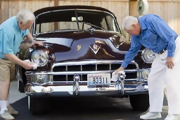 Seniors polishing up a classic antique 1950s Cadillac at Áegis of Bellevue. (Courtesy Áegis Living)