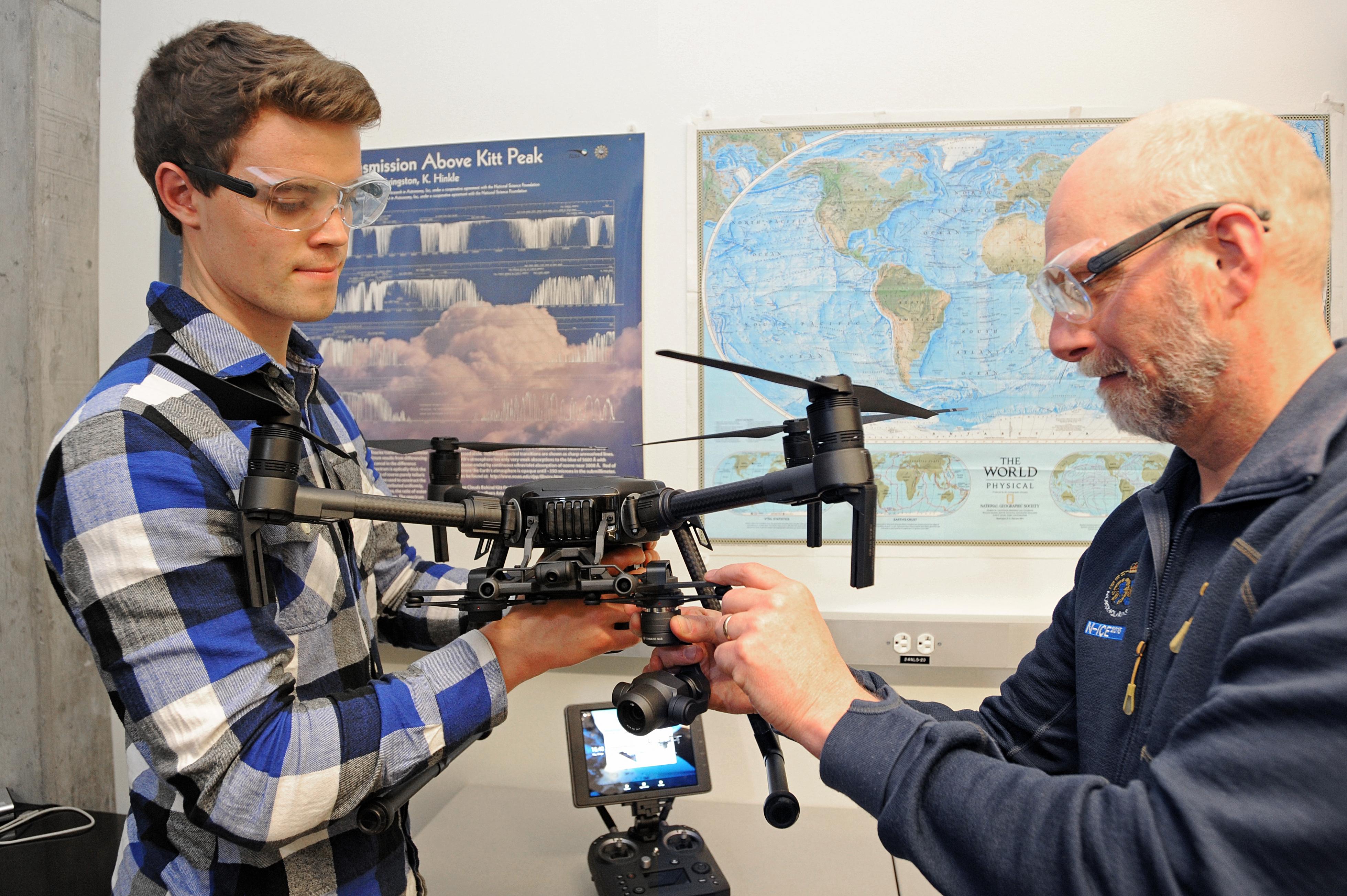 National scholarship recipient Kristian Gubsch examines an aerial drone with Professor Von Walden