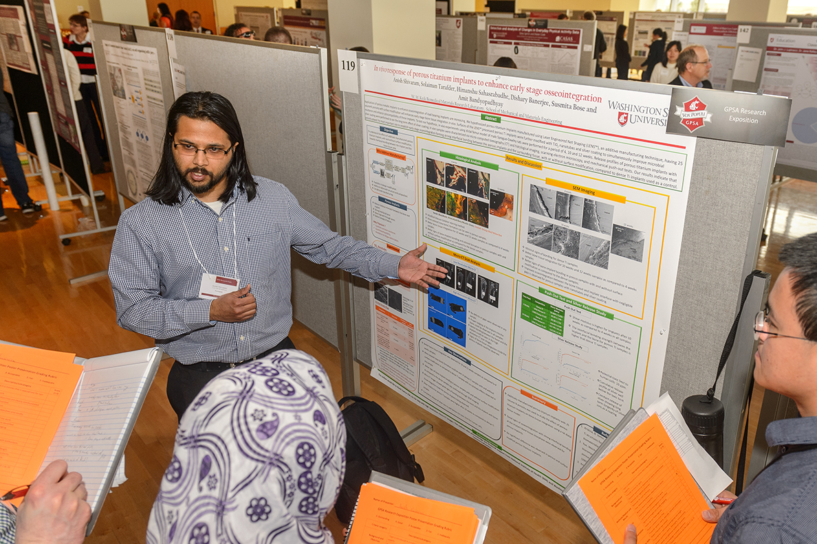 WSU graduate student sharing his research with others during Showcase.