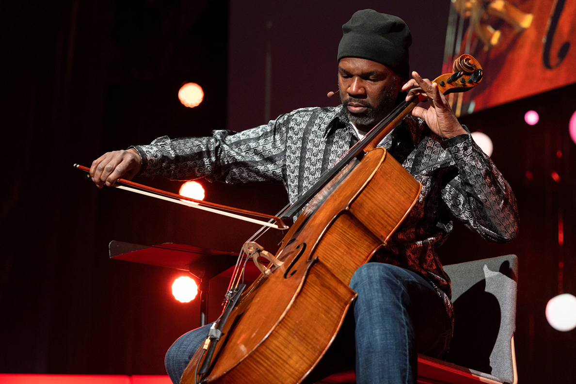 Rucker on stage playing cello.