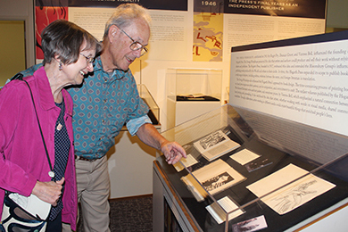 WSU professor emerita of English Diane Gillespie and husband Dick Domey look over books in the Hogarth Press book collection in Manuscripts, Archives and Special Collections.