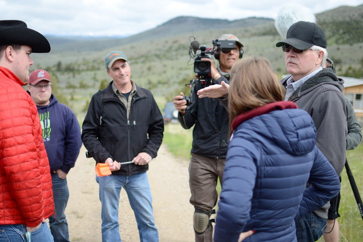 Documentary filmmakers interviewing people on location.
