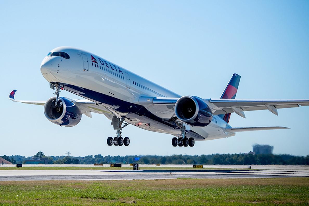 Delta airliner preparing to land on runway.