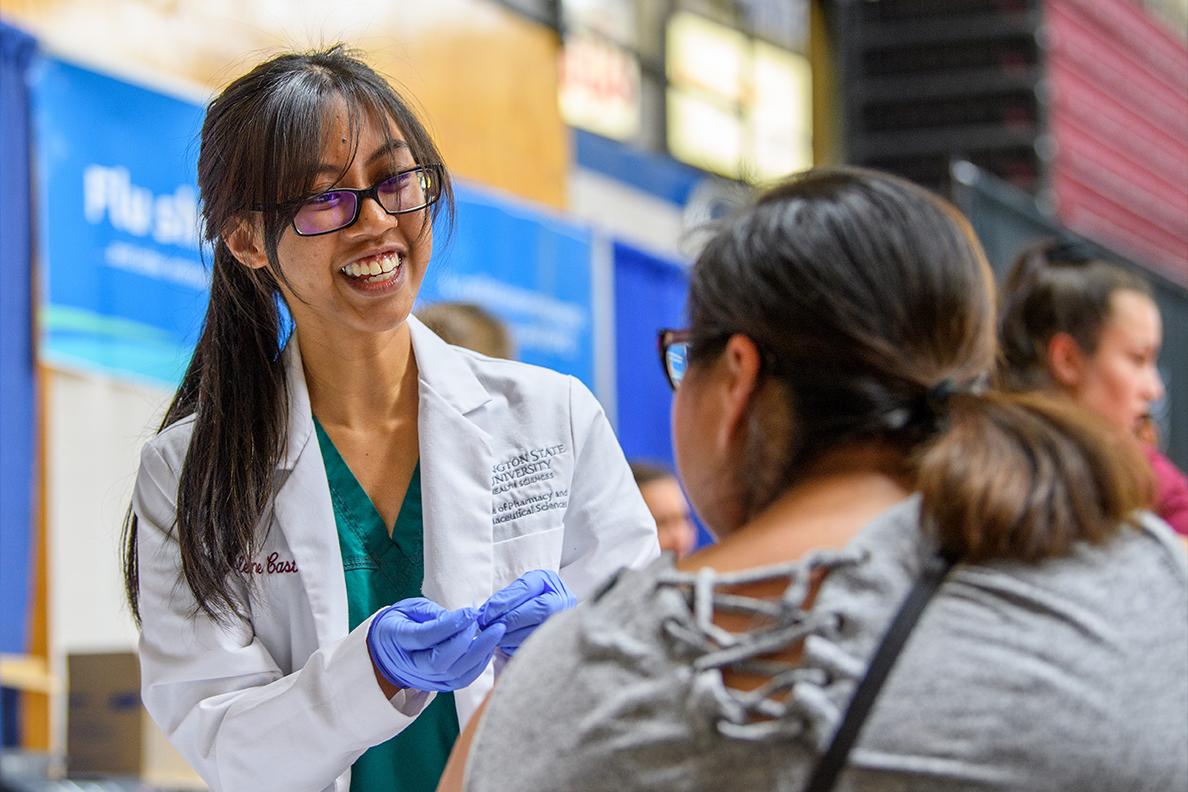 A student pharmacist gives an immunization.