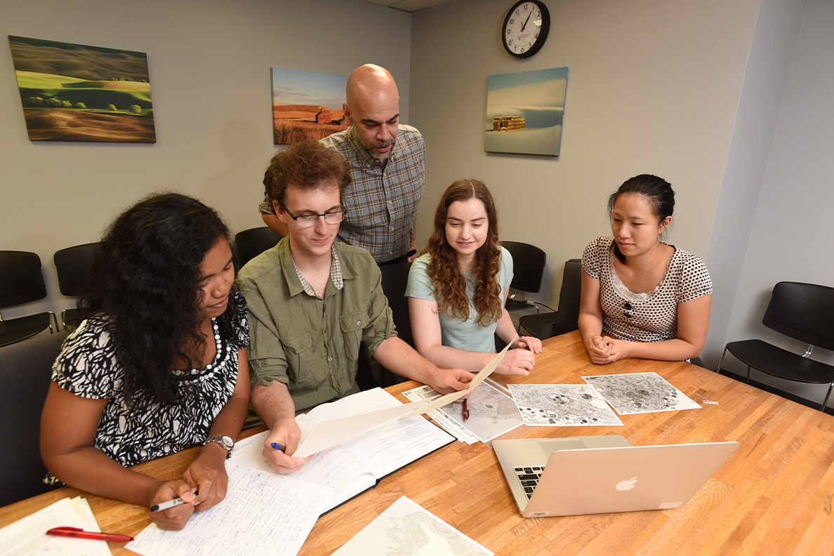 Members of the Nicola Laboratory (left to right) Tri Komala Sari, Seth Schneider, Anthony Nicola, Katrina Gianopulos and Becky Lee review data outside of the lab.