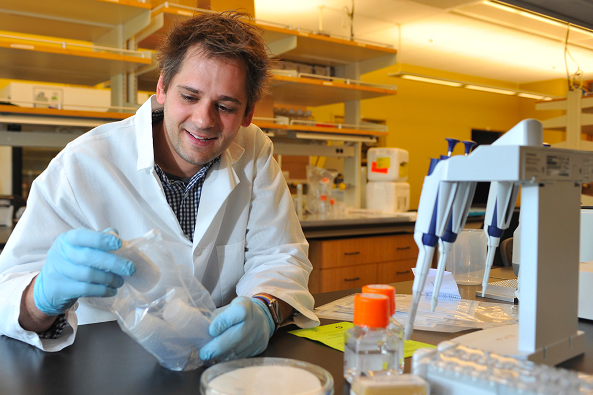 Closeup of Michael Letko working in a lab.