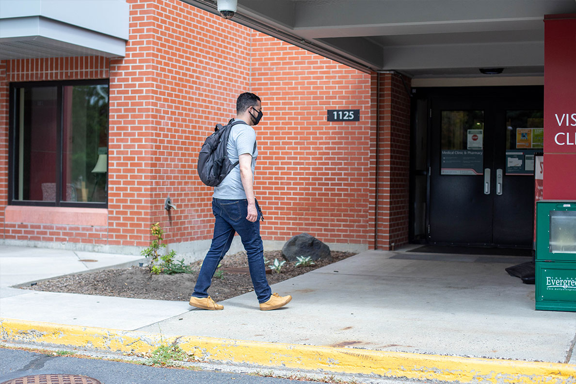 A student walks into Cougar Health Services.