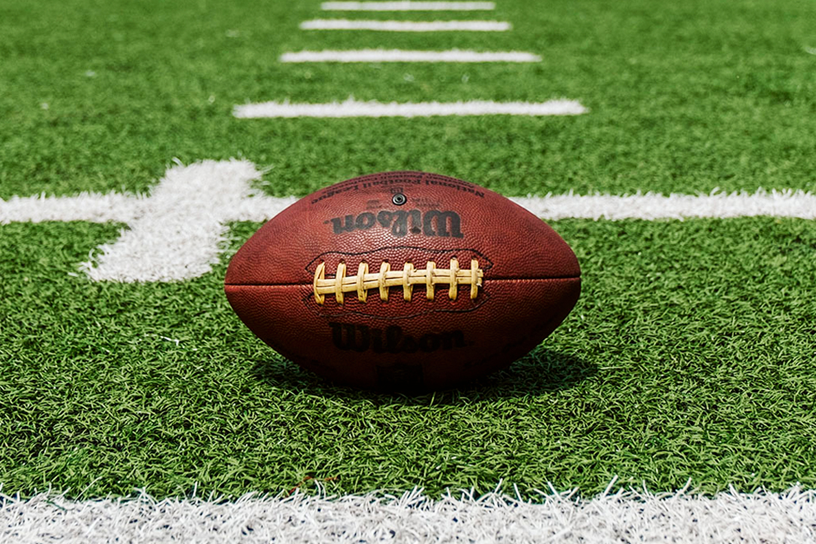An American football set on an empty field.