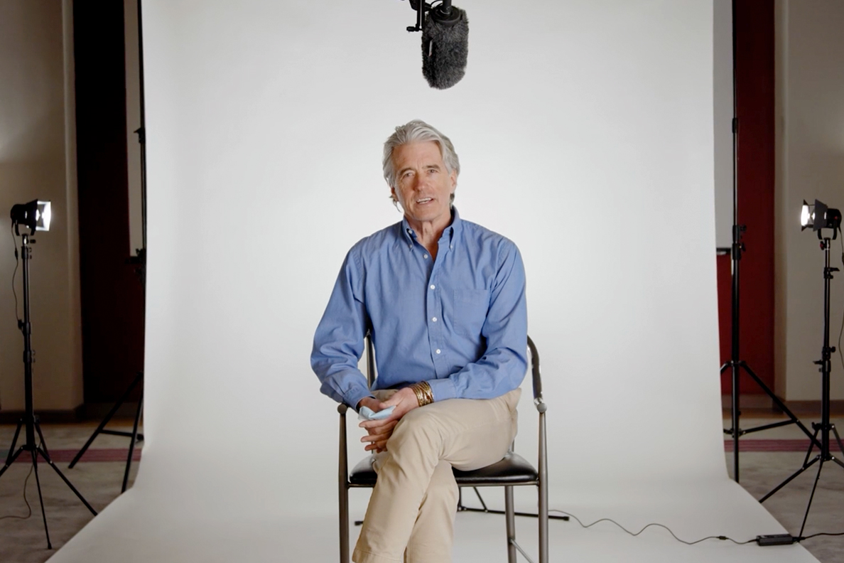 Guy Palmer sitting on set for a video FAQ session.