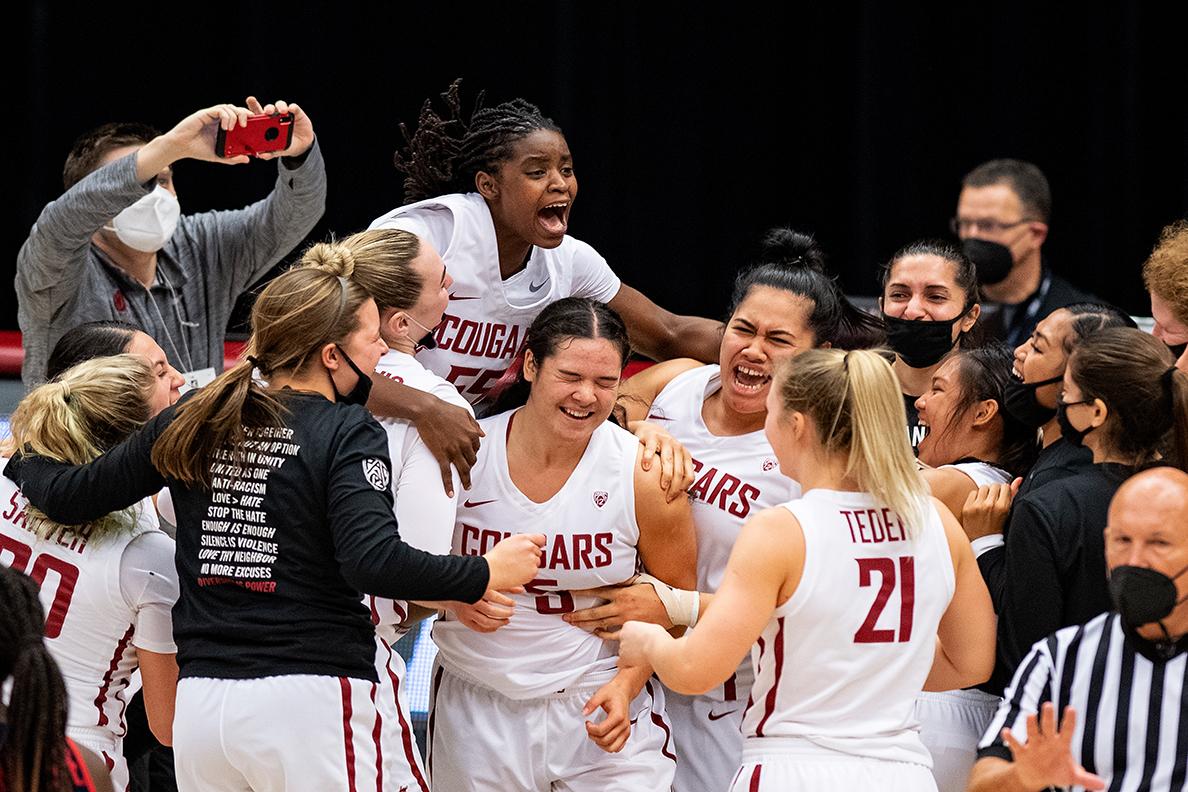 WSU women's basketball celebrating win