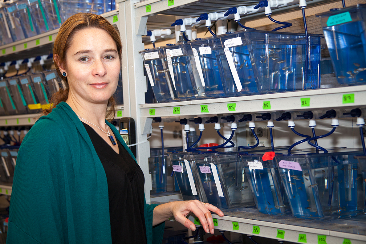 Allison Coffin stands in front of shelves filled with containers