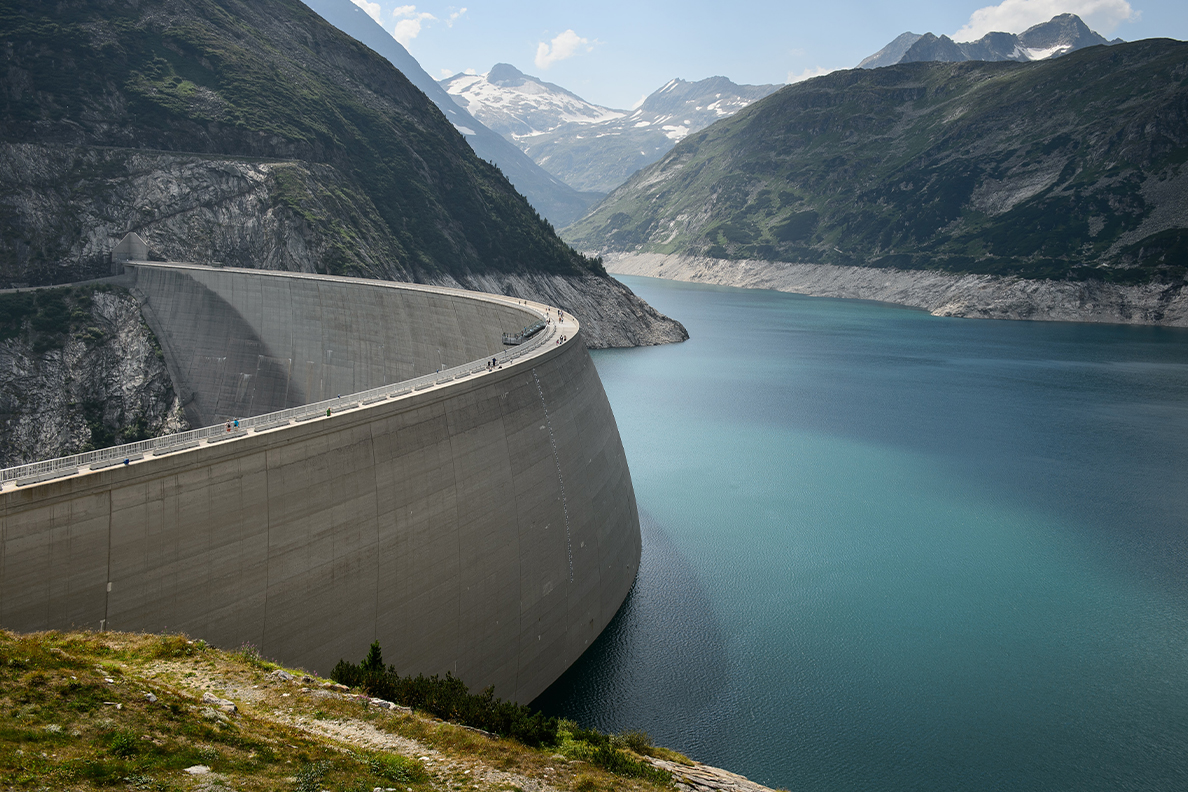 A large water reservoir resting behind a dam.