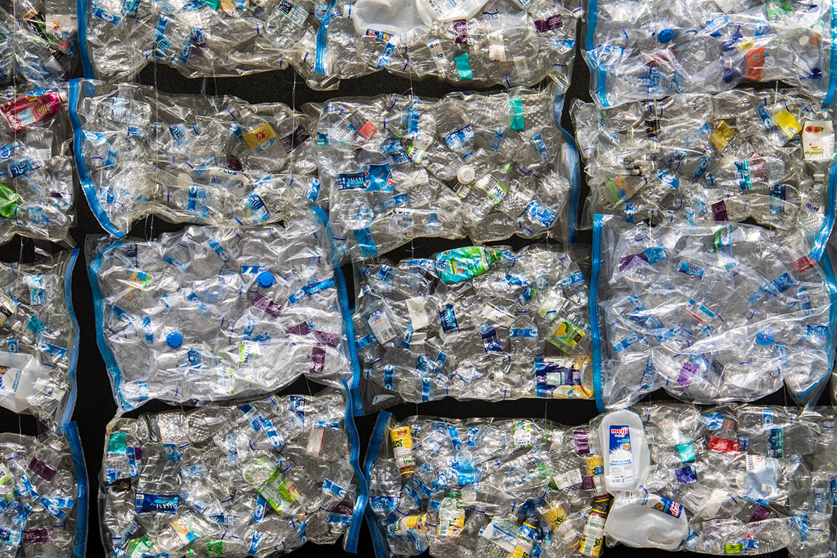 Part of a wall in the centre of Singapore, made out of plastic wastee in vacuum sealed bags