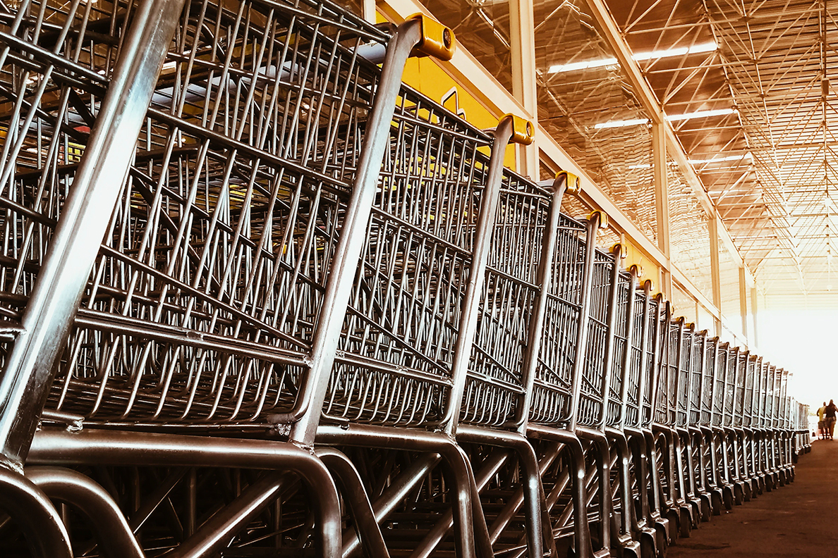 Closeup of a long row of nested shopping carts.