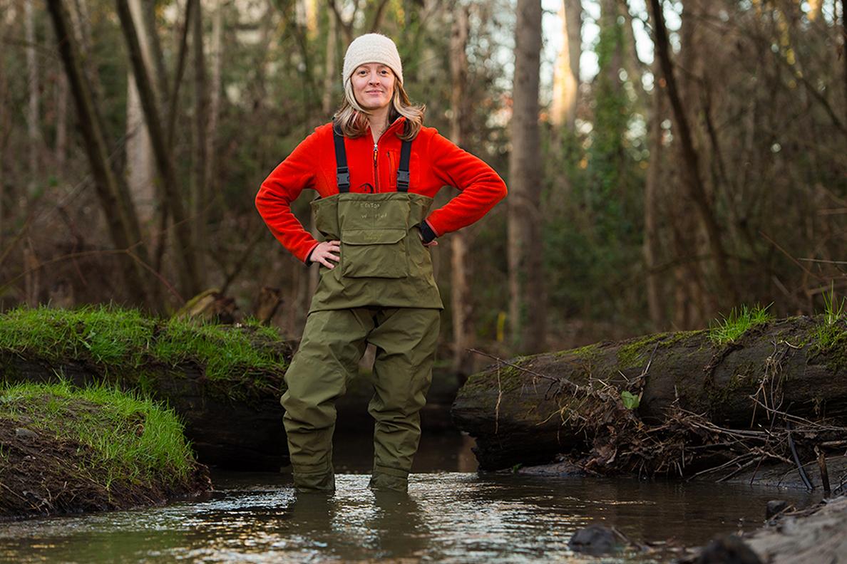Jen McIntyre wearing waders as she stands in Longfellow Creek.
