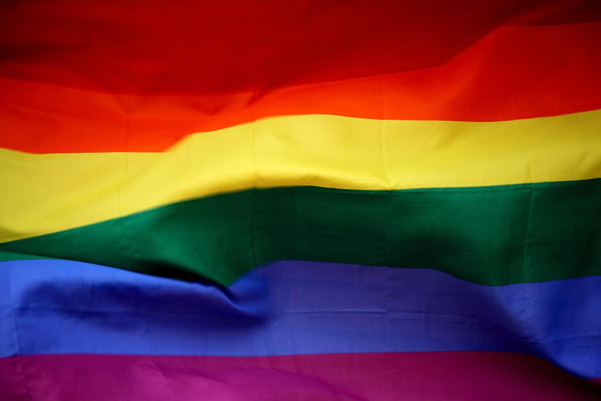 Closeup of a rainbow-colored flag.