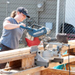 An architecture student works on a Habitat for Humanity home.