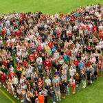 The 2021 sophomore class of WSU Pullman students gathered into a heart shape on an outdoor practice field.