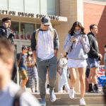 WSU Pullman students walking outside of the Compton Union Building.