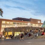 WSU Pullman students walking across Glenn Terrell Mall at night.