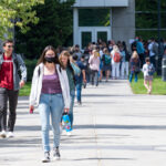 Students walking in and out of a building on the WSU Spokane campus.