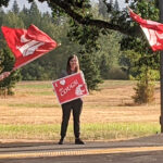 WSU Vancouver faculty, staff, alumni, and friends wave WSU Cougars signs and flags on the first day of classes.