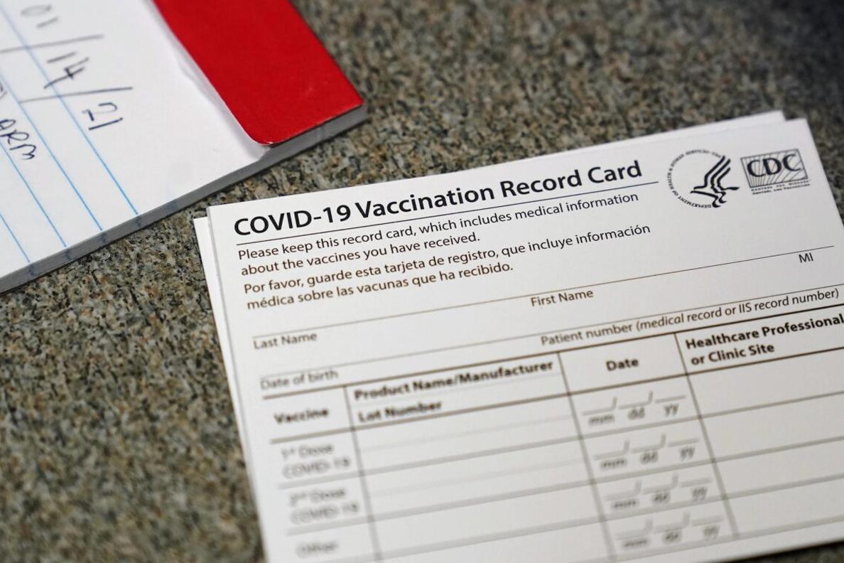 Closeup of a COVID-19 vaccination record card.