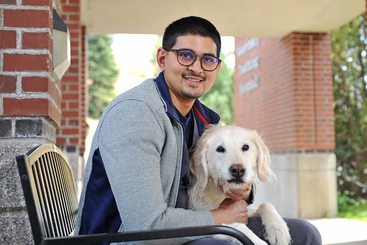Closeup of Neil Sinha and his dog Molly.