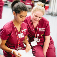 Two nursing students studying