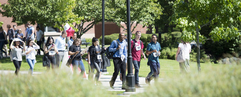 Photo of diverse group of students walking on campus