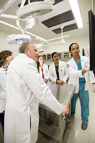 medicine professor and students in anatomy lab