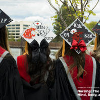 Four College of Nursing graduates standing in a line