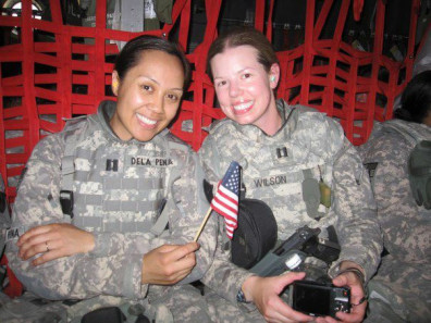 Arlyn coming home from deployment in 2011 with battle buddy CPT Kris Wilson.