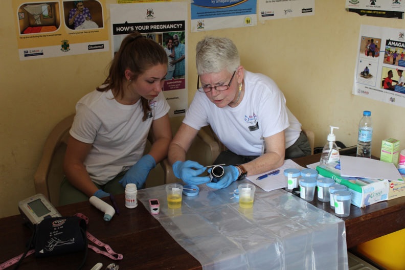 Anita Hunter, right, with Vancouver high school student Chris Bevin in Uganda