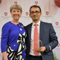 Assistant Dean Jo Ann Dotson, left, with Anas Mohammad, right.