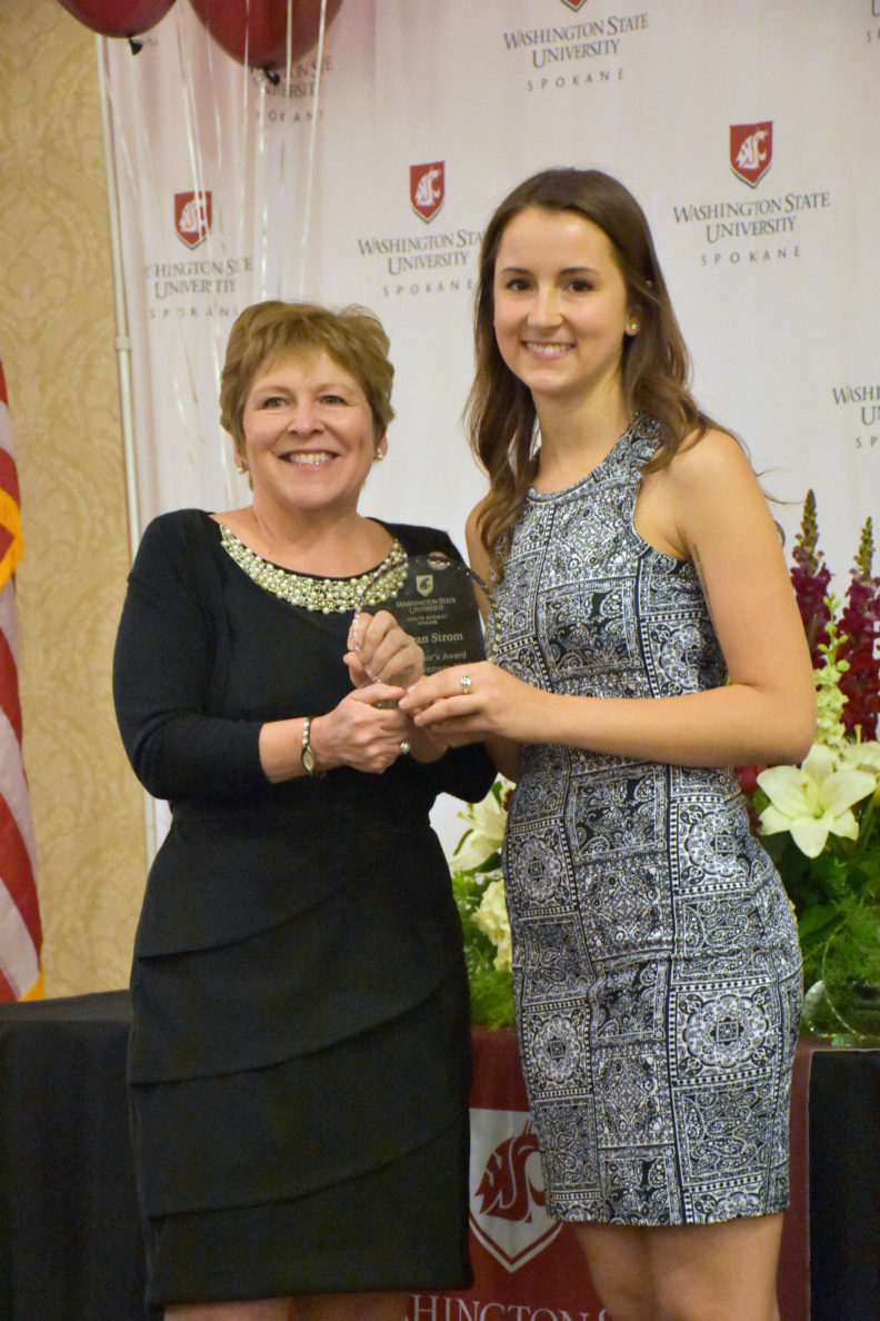 Megan Strom, right, accepts a Chancellor's Award from WSU Spokane Chancellor Lisa Brown, left, at the 2017 Commencement Breakfast.