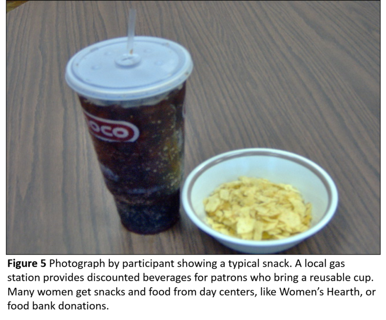 Photo of a large plastic cup of cola and a bowl of what looks like potato chips.