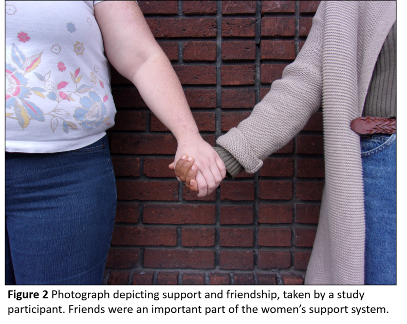 An image of two women holding hands.