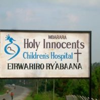A sign for Holy Innocents Children's Hospital in Mbarara, Uganda