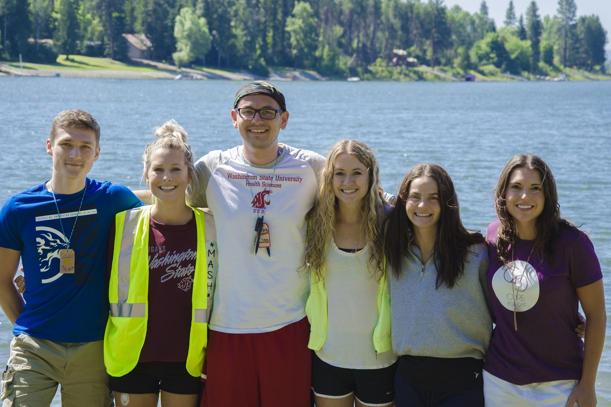 Group of nursing students standing arm in arm at Camp Stix.