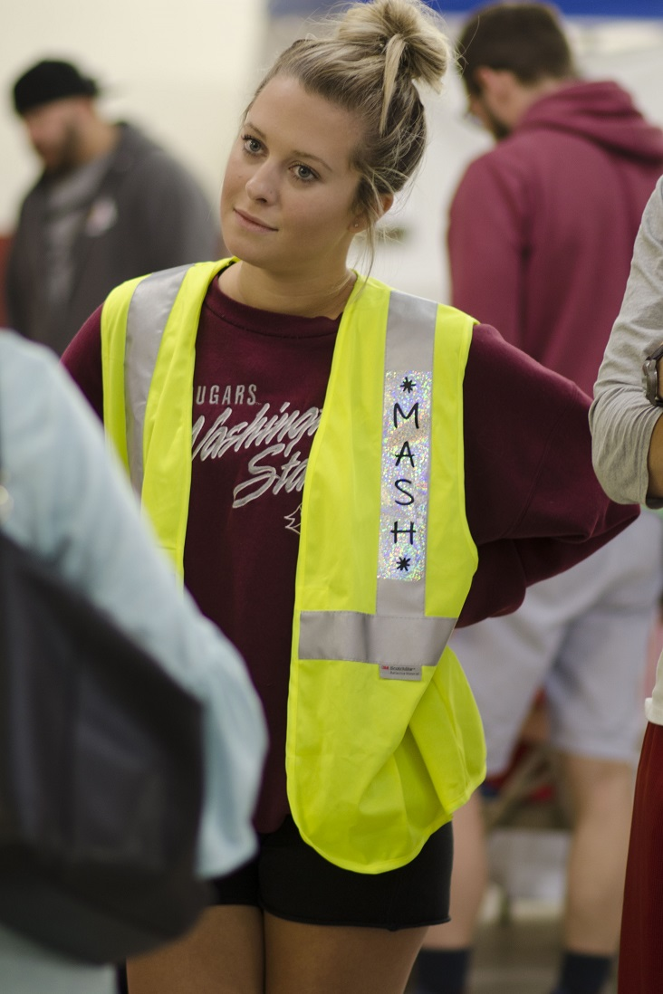 Photo of Lauren McClanahan with a bright vest that says MASH