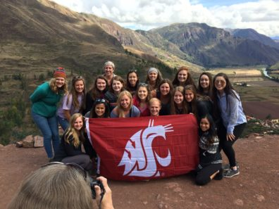 Group of WSU Students with a Coug flag in Peru