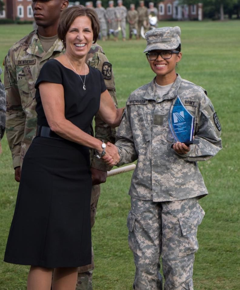 Photo of Cadet Madriaga shaking hands with a representative of Norton Healthcare.