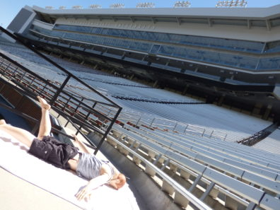 Photo of Sim Man mannequin laying in the stands at the football stadium in Pullman.