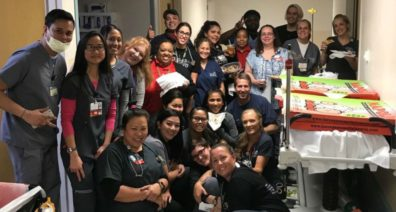 Staff at Sunrise Hospital in Las Vegas took a picture with the pizzas sent by ER staff at Providence Sacred Heart Medical Center in Spokane.