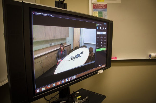Dr. Wendy Buenzli of the WSU College of Nursing talked about continuing education during an event with WSU Extension in Island County; here she's shown on a monitor used to link up the Spokane campus with the office on Whidbey Island.